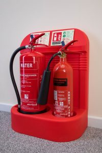 Abbot Fire Group branded water and Co2 fire extinguishers in stand